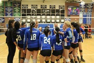 vballblairnov11Coach Cindy Hillard and team celebrating with the team after the win