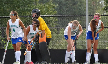 Junior Goalie Juliet Twomey and the defensive team Martinia Rebade, Satare Aliakbar, Sydney Small, and Robyn Peterson defend a BCC offensive corner