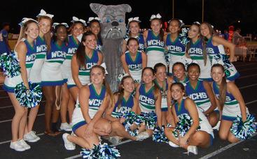 Varsity Cheerleaders Bond with the Bulldog